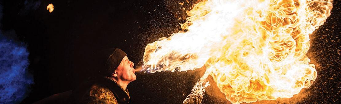 Performing fire eater